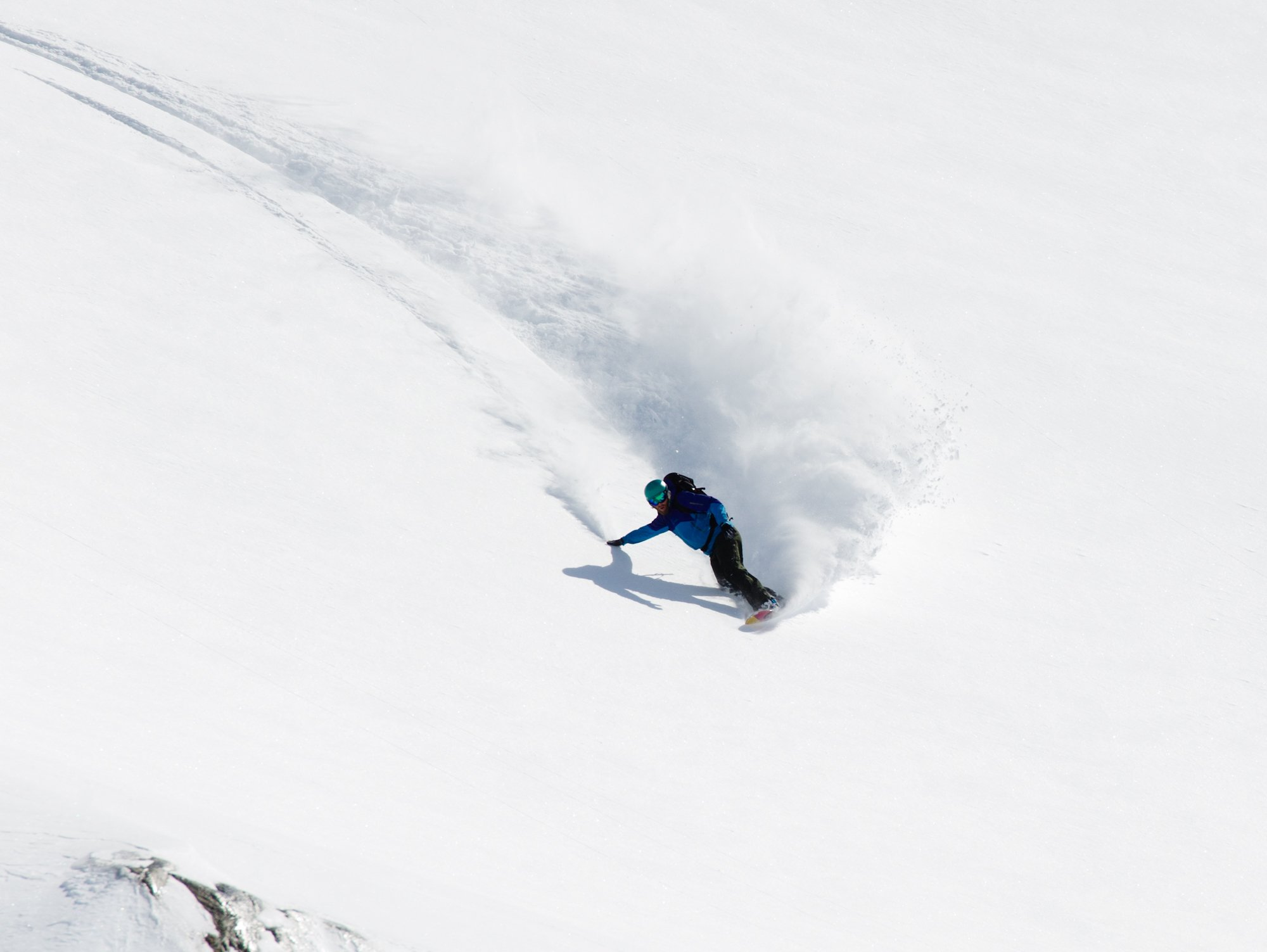 Deep Powder days on a custom, Savage Panda Snowboard Photo by Vince Shuley